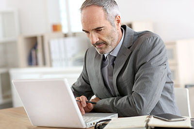 senior business owner on laptop