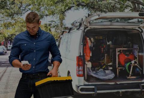 tradie-outside-van-on-phone-2142x1415